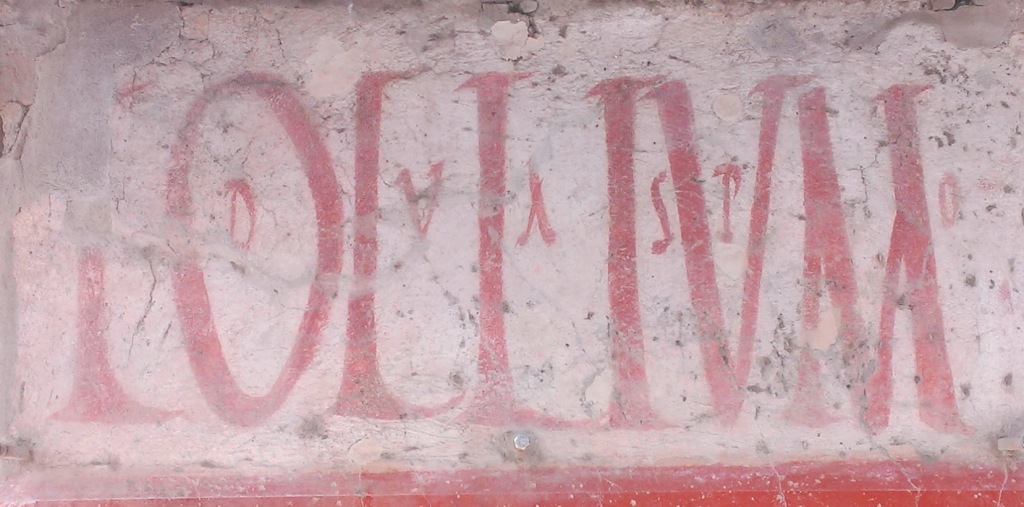 Shopfront lettering at Pompeii. (Photo by the author.)
